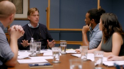 Aaron Sorkin explaining a concept to students at a table