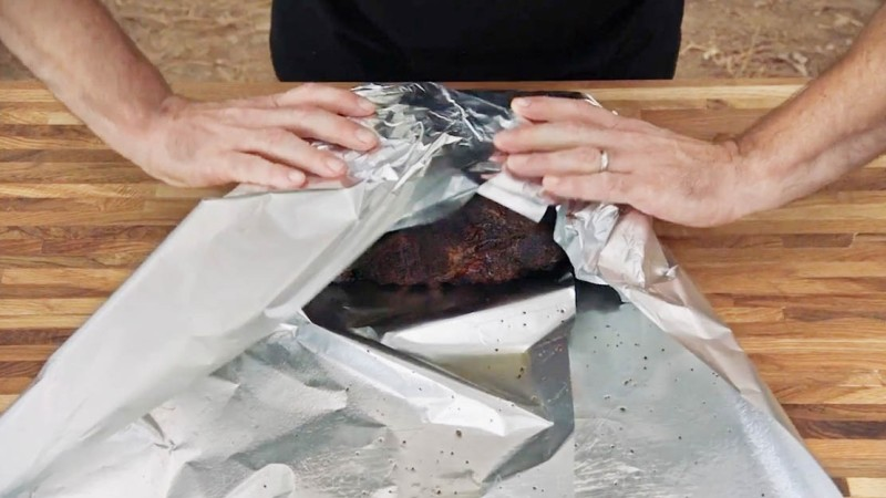 Aaron Franklin wrapping brisket in foil