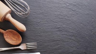Cooking utensils on black background