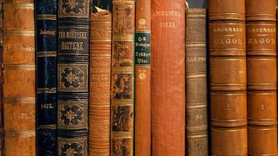 Vintage brown and black books on shelf