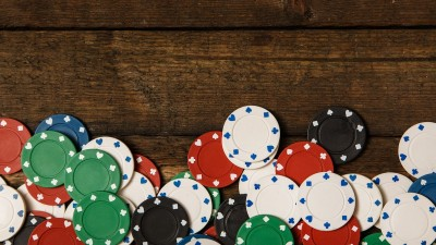 Poker chips on wood
