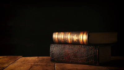Stack of old books on wood table