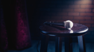 a microphone on a stool on a stage