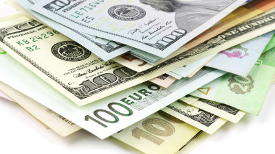 hundred dollar bills in different currencies
