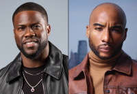Kevin Hart is wearing a black leather jacket and black shirt. Charlamagne tha God is wearing a brown leather jacket and light brown turtle neck.