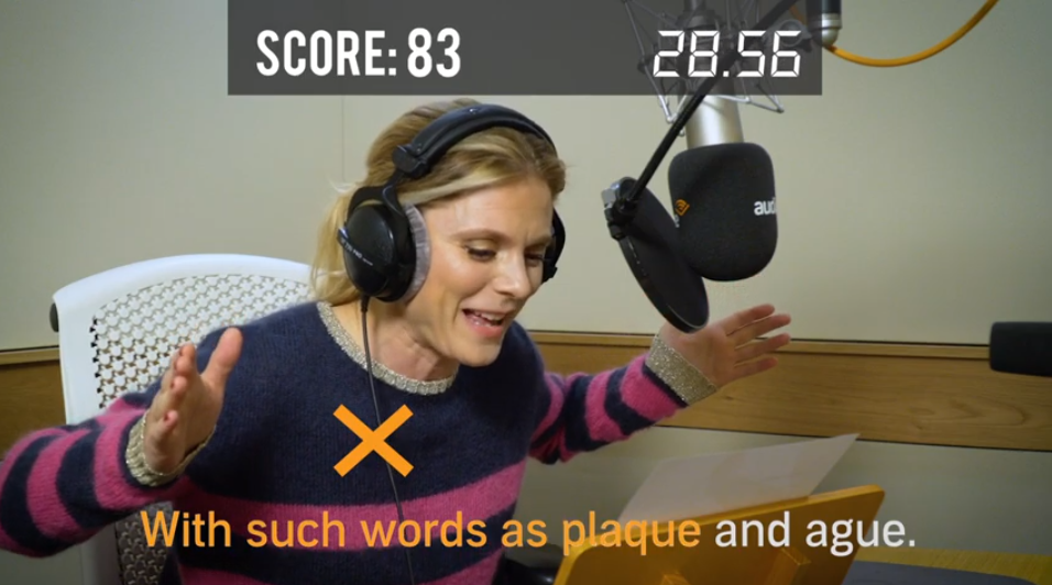 Emilia Fox sits at the microphone excitedly narrating Audible UK's Tongue Twister Challenge.