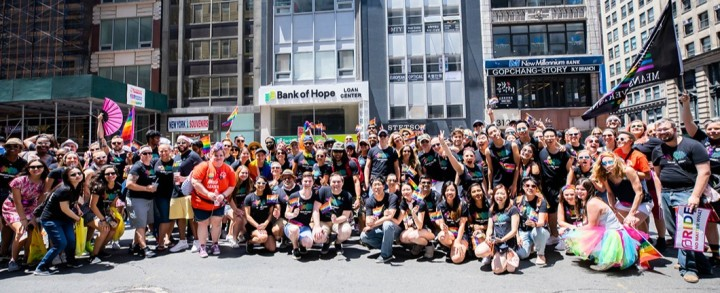 Audible employees and members of Queer Newark Oral History gather together at World Pride March in NYC.
