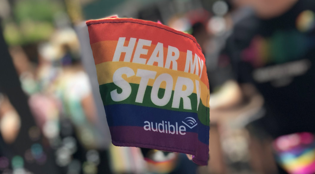 The Audible Pride flag is raised proudly at the World Pride March in NYC.