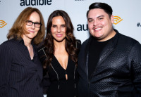 Directo Jo Bonney, actress Kate del Castillo and playwright Issac Gomez pose together in front of an Audible backdrop.