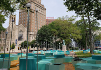 Blue hexagon seats, tables and planters and solar lights in Washington Park in Newark.