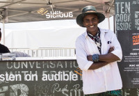 "World renowned chef Marcus Samuelsson stands in front of the ""Our Harlem"" foodtruck."