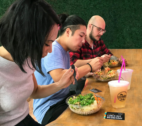 Three Audible employees eat at the counter of a local Newark restaurant for Lunch Out Wednesday.
