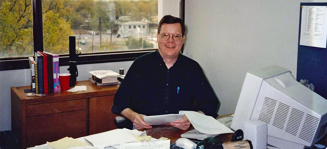 Rick Lewis at his desk in 1996
