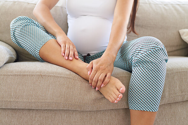 Mum-to-be nurses her swollen ankles
