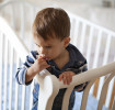 Toddler standing up in his crib.