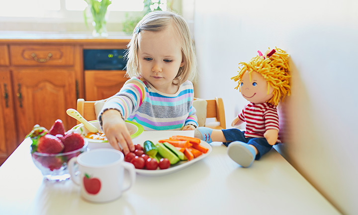 Toddler eating snack