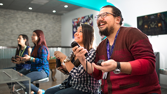 Man and woman playing video games laughing
