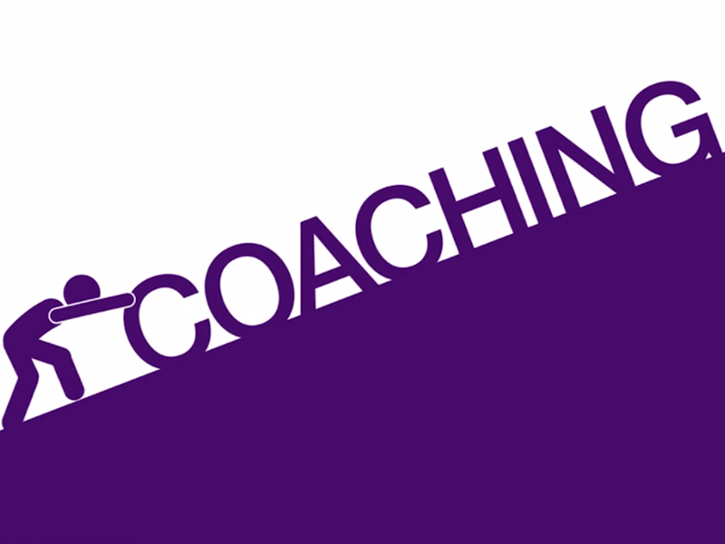 human icon pushing the words 'coaching' up a hill
