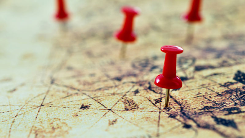 Push pins on a historical map - employee journey mapping concept