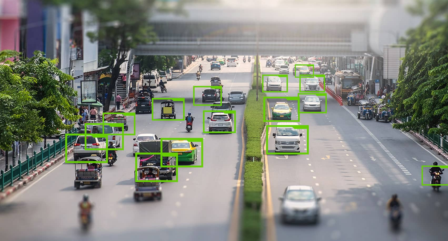 A busy street with traffic and people, which have been highlighted for AI data software