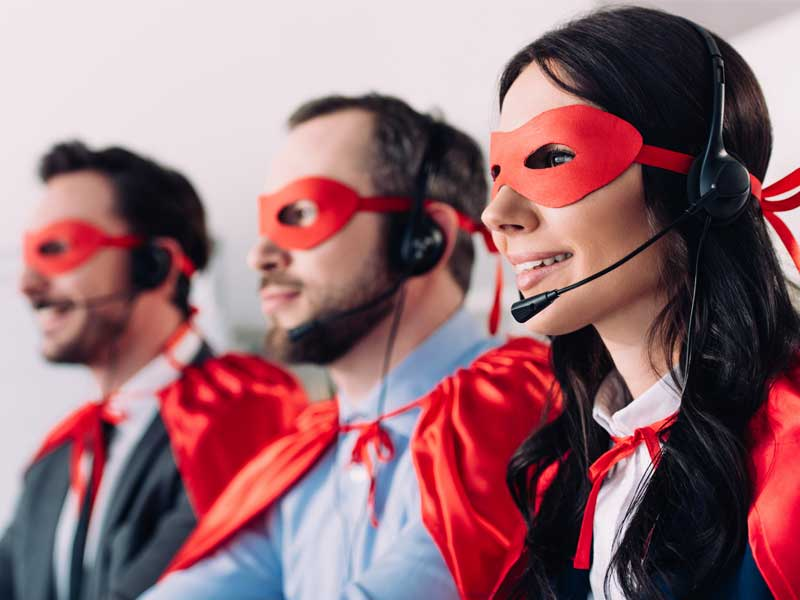 contact center agents wearing superhero masks