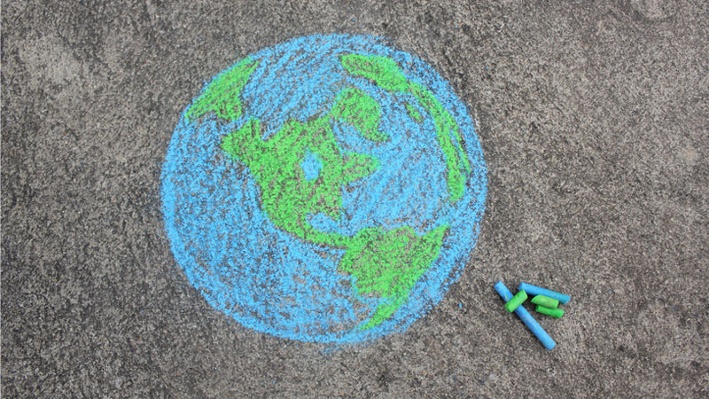 image of world drawn on pavement with chalk