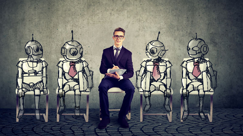 human employee sitting between bots