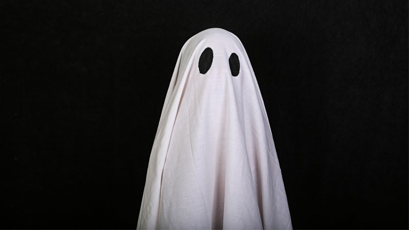 bed sheet wearing ghost