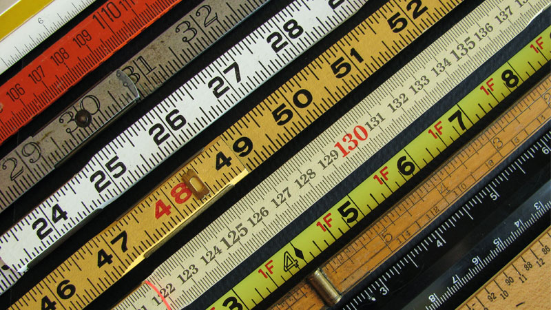 row of tape measures in various colors and sizes