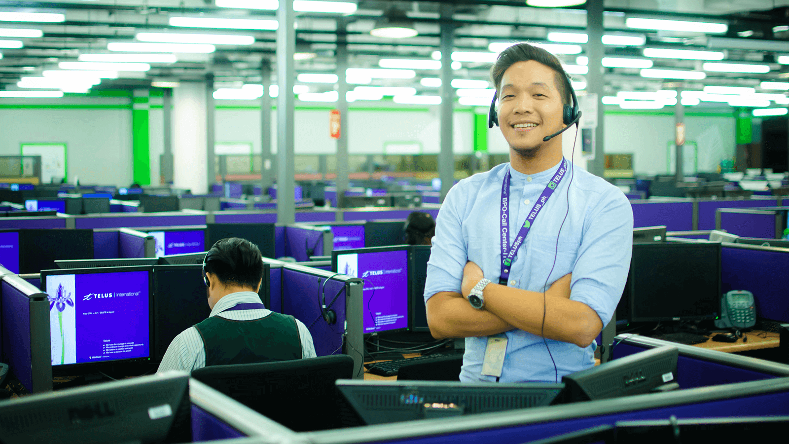 Call centre employee standing by his desk