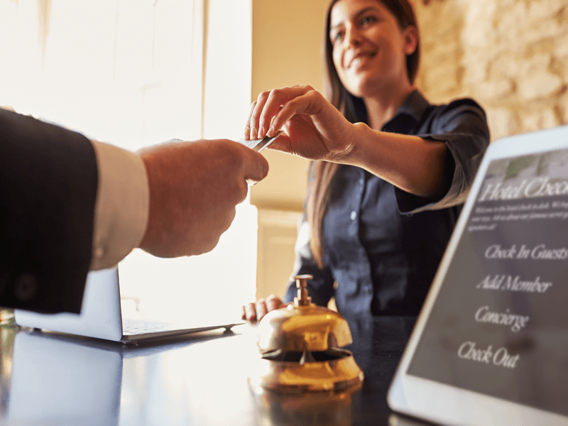 Female customer paying at hotel