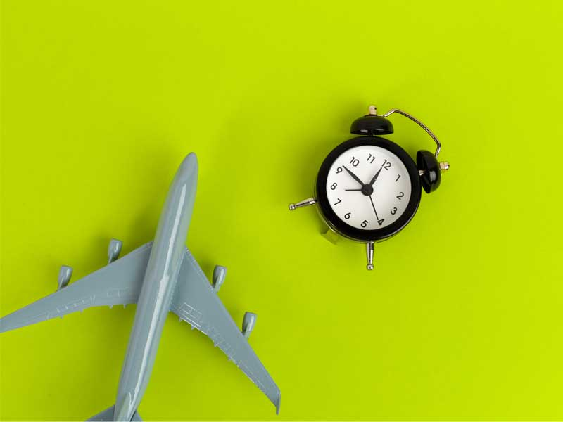 model plane beside a clock
