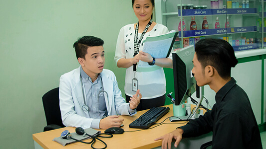 A patient meeting with a doctor for a consultation