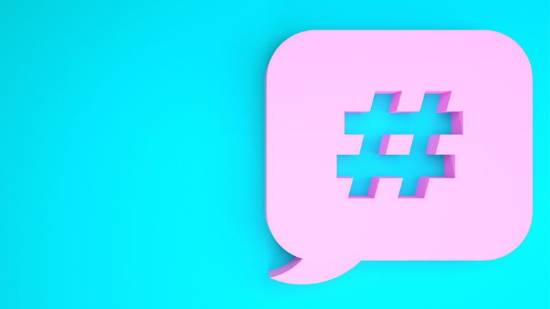 pink speech bubble with hashtag symbol on blue background