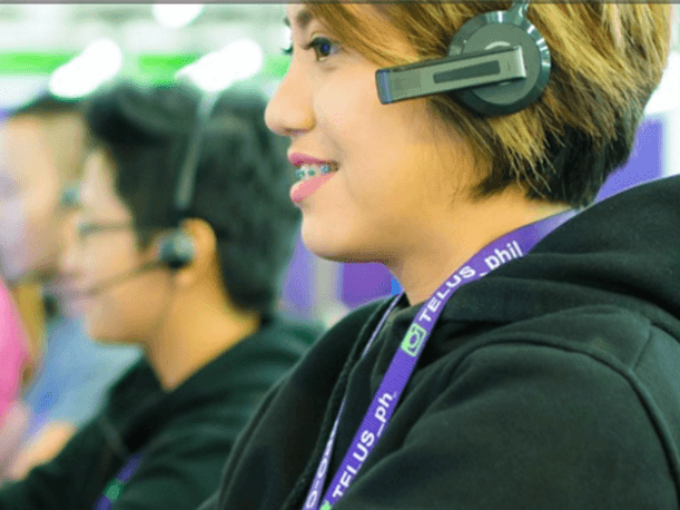 agent in a contact center on a headset