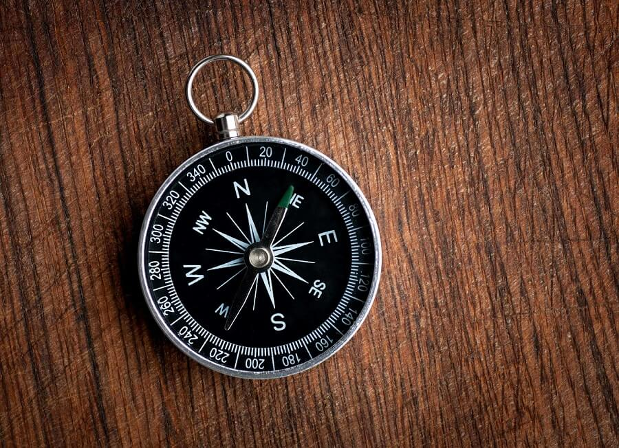 compass on wood background