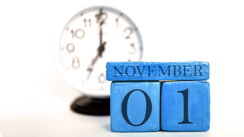 November 1 calendar with clock behind it