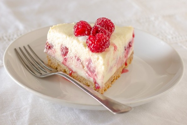White Chocolate and Raspberry Cheesecake from Cake Crumbs and Beach Sand