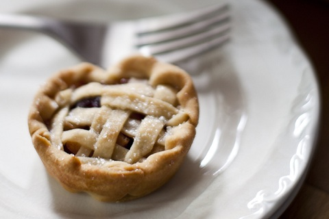Mini Apple-Cranberry Pies Infused with Spiced Rum