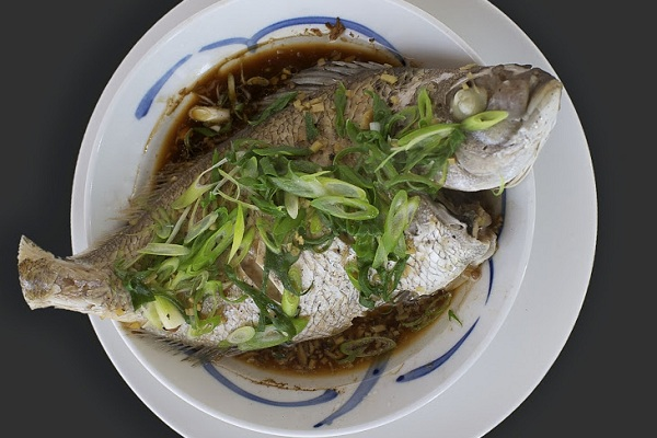 Steamed whole snapper with Soy, Ginger, and Spring Onions from Food52