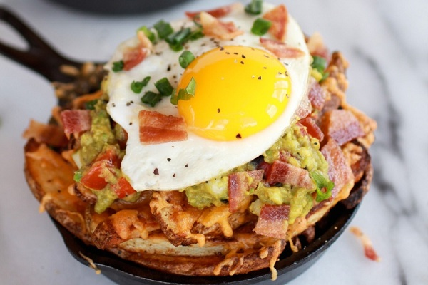 Cheesy Cajun Fries with Grilled Corn Guacamole, Bacon and Fried Eggs from Half Baked Harvest