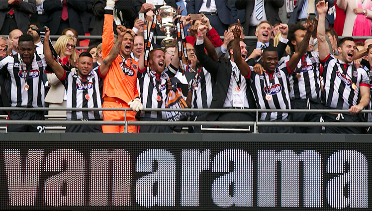 The #VanaramaUltimateFan presents the National League promotion final trophy at Wembley Stadium