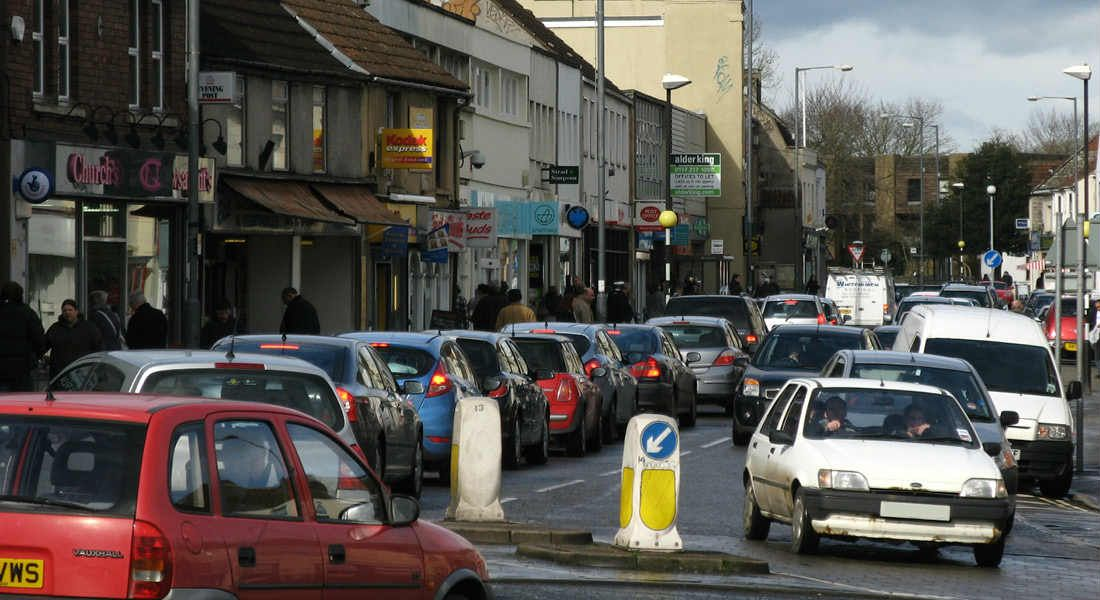 crowded high street road with no parking space