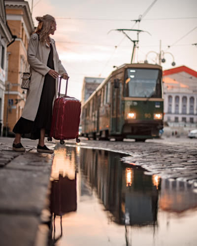 Passenger waiting for a tram in Senate Square