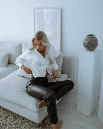 Influencer wearing faux leather pants from House of Brandon