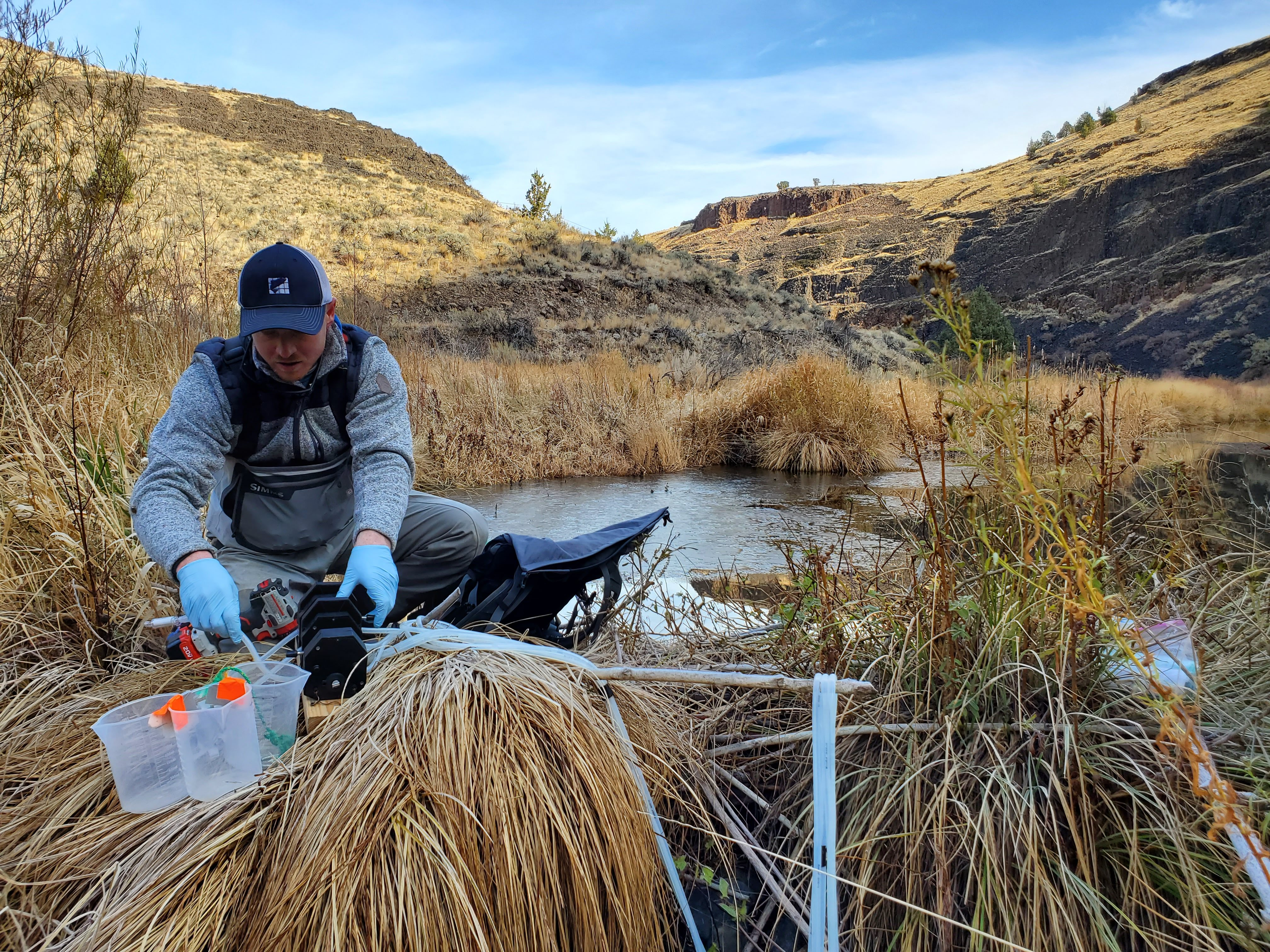 One of the researchers sets up equipment to take eDNA samples.