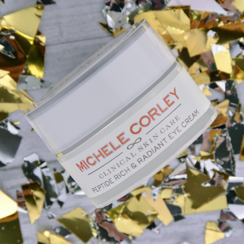 Retail Peptide Rich & Radiant Eye Cream that appears to be floating with confetti in the background.