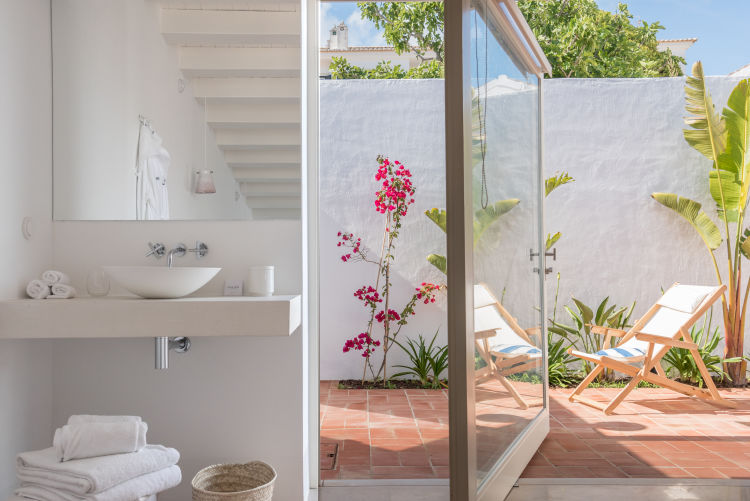 cabanas bathroom and exterior