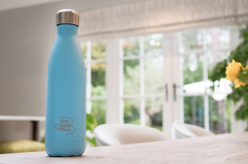 A Chilly's water bottle branded with The Body Coach.