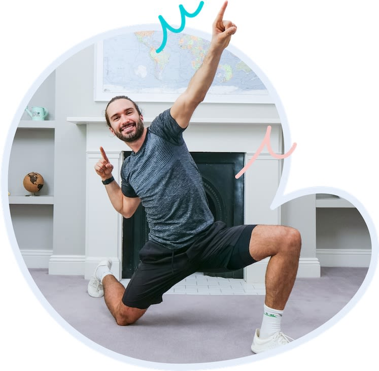 Joe Wicks kneeling down striking a pose